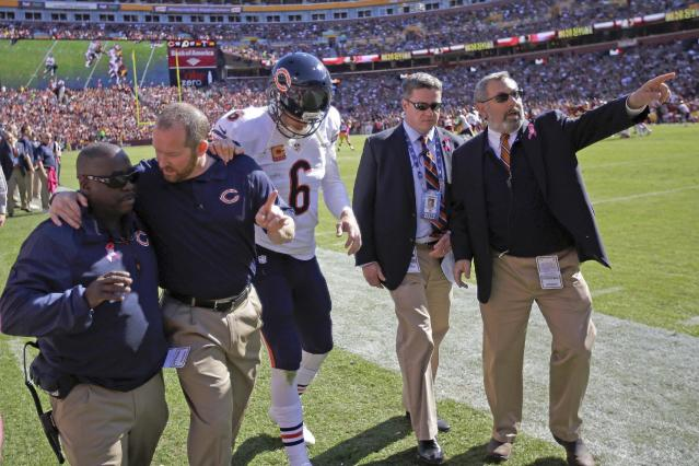 Chicago Bears quarterback Jay Cutler walks off the field after being injured by a sack from Washington Redskins defensive end Chris Baker during the first half of a NFL football game in Landover, Md., Sunday, Oct. 20, 2013. (AP Photo/Alex Brandon)
