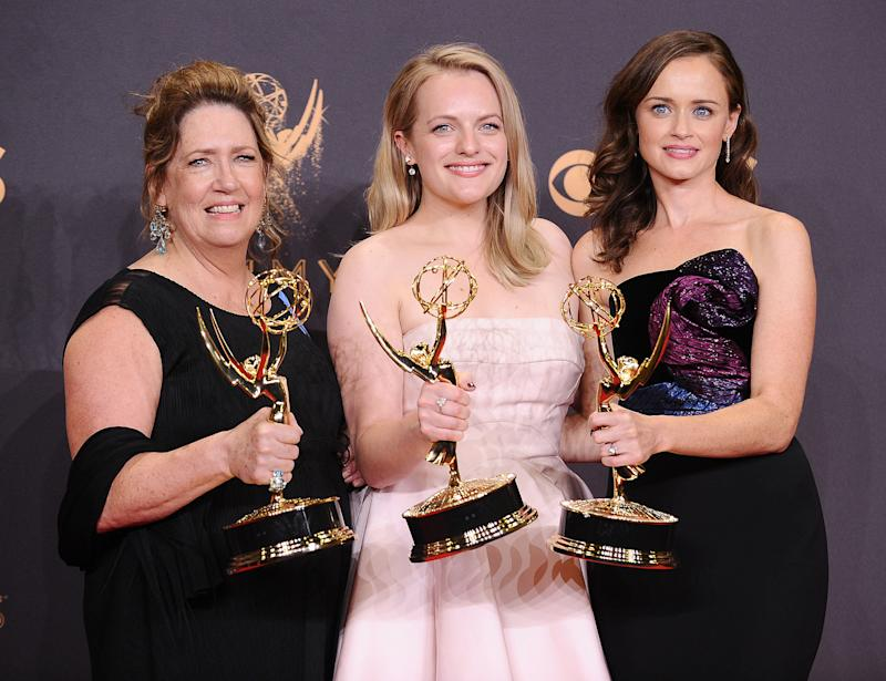 """Actors Ann Dowd, Elisabeth Moss and Alexis Bledel pose with their acting Emmys for """"The Handmaid's Tale."""" (Jason LaVeris via Getty Images)"""