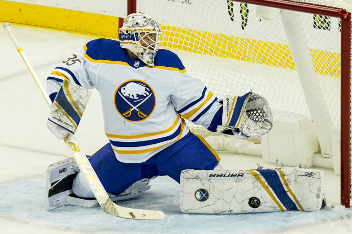 Buffalo Sabres goaltender Linus Ullmark (35) makes a save during the second period of an NHL hockey game against the New Jersey Devils, Saturday, Feb. 20, 2021, in Newark, N.J. (AP Photo/John Minchillo)