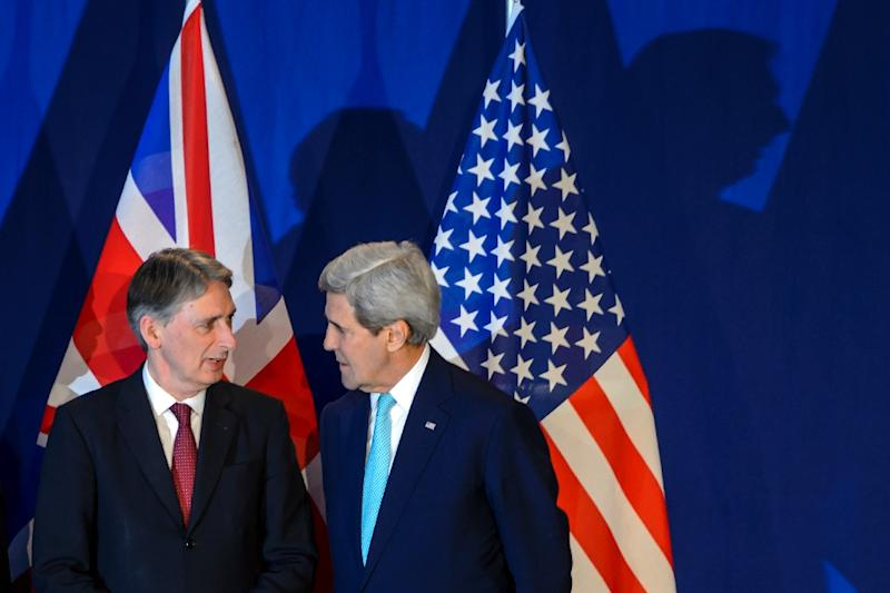British Prime Minister David Cameron's first moves after the election auger continuity rather than change and the reappointment of Foreign Secretary Philip Hammond, picturec (L) with US Secretary of State John Kerry in April, has raised eyebrows (AFP Photo/Fabrice Coffrini)