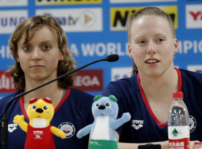 United States swimmer Lilly King, right, and Katie Ledecky take questions during a press conference at the World Swimming Championships in Gwangju, South Korea, Friday, July 19, 2019. (AP Photo/Lee Jin-man)