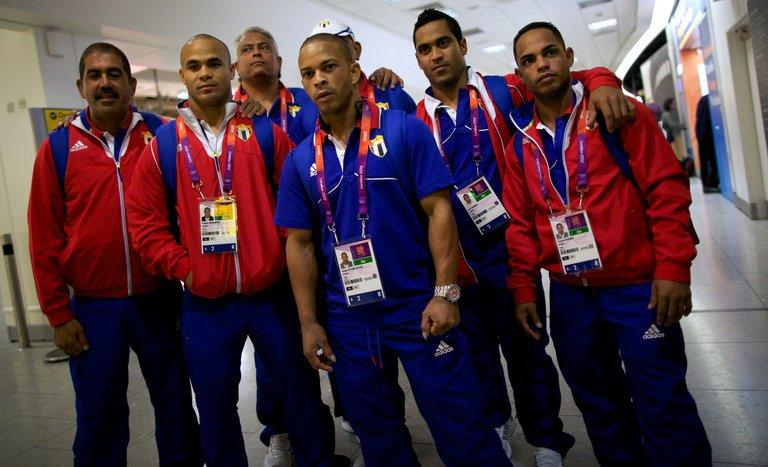 Members of Cuba's Olympic weightlifting team at Heathrow airport in London on July 16, 2012