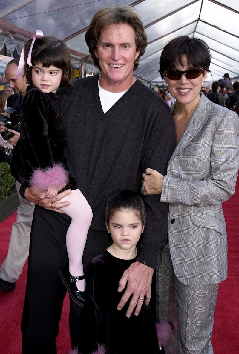 HOLLYWOOD, : Former US gold medal decathlete Bruce Jenner (C), his wife Kris (R) and children Kylie (L) and Kendall (BELOW) appear at the, 10 December 2000, premiere of Walt Disney's 'The Emperor's New Groove' at the El Capitan Theater in Hollywood, CA. The film opens in the US on 15 December 2000 AFP Photo/Scott NELSON (Photo credit should read Scott Nelson/AFP/Getty Images)
