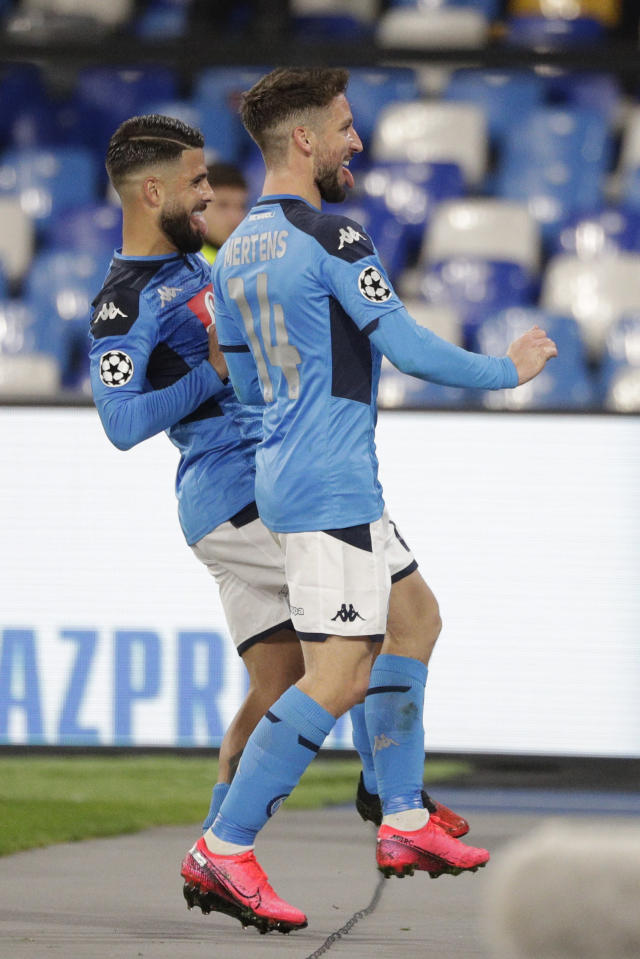Napoli's Dries Mertens, right, celebrates with teammate Lorenzo Insigne after scoring during the Champions League, Round of 16, first-leg soccer match between Napoli and Barcelona, at the San Paolo Stadium in Naples, Italy, Tuesday, Feb. 25, 2020. (AP Photo/Andrew Medichini)