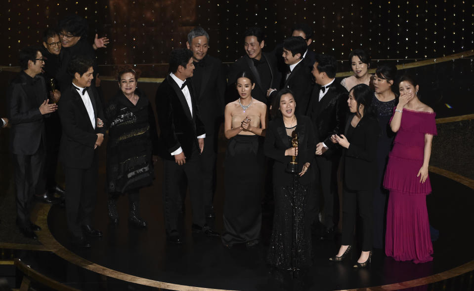 """The cast and crew of """"Parasite"""" accept the award for best picture at the Oscars on Sunday, Feb. 9, 2020, at the Dolby Theatre in Los Angeles. (AP Photo/Chris Pizzello)"""
