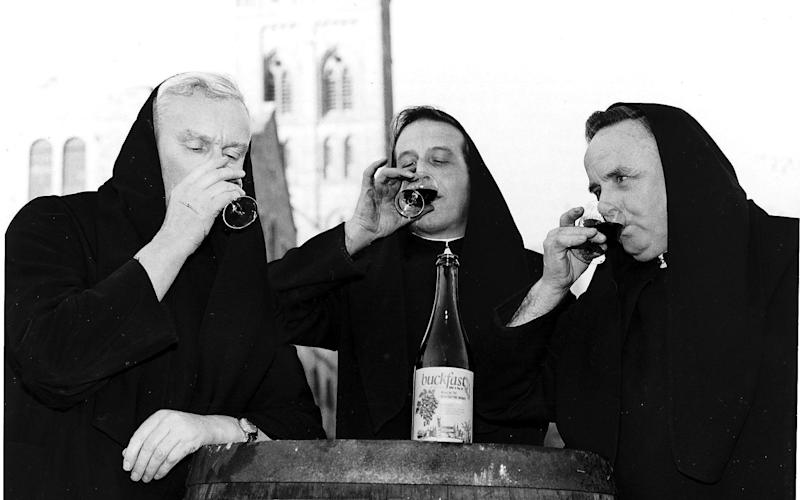 Homemade Buckfast wine being drunk by Father Leo, Brother Sebastian and Father Alban - Credit: ALAMY