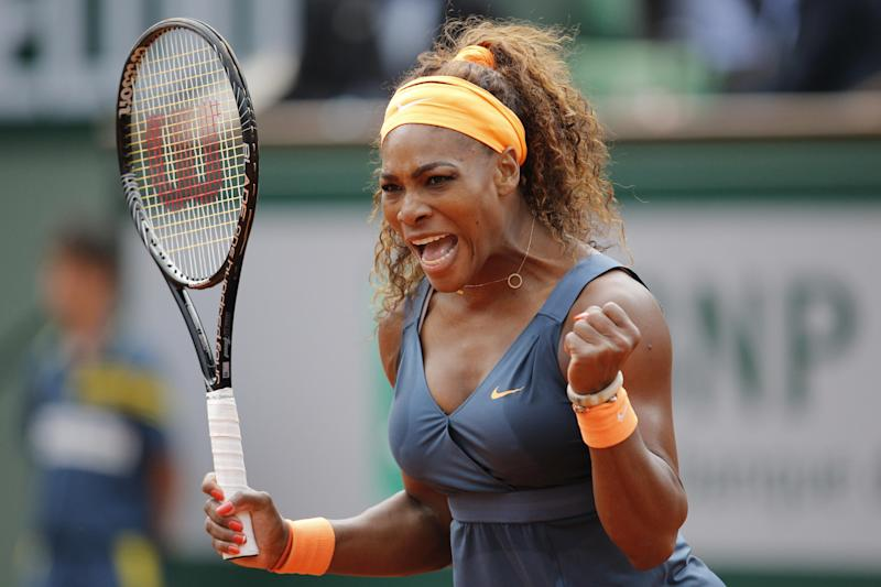 Serena Williams of the U.S. celebrates scoring a point against Caroline Garcia of France in their second round match of the French Open tennis tournament, at Roland Garros stadium in Paris, Wednesday, May 29, 2013. Williams won in two sets 6-1, 6-2.(AP Photo/Christophe Ena))