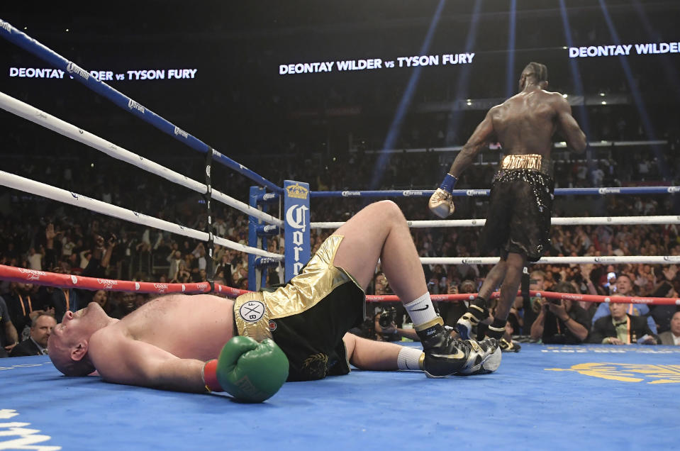 Tyson Fury lies on the canvas after being knocked down by Deontay Wilder in the 12th round. (AP Photo/Mark J. Terrill)