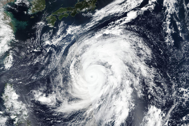 This Oct. 9, 2019, satellite photo taken by NASA-NOAA's Suomi NPP satellite shows typhoon Hagibis approaching Japan, top.  Japan's weather agency is warning a powerful typhoon may bring torrential rains to central Japan over the weekend. Typhoon Hagibis had winds gusting up to 270 kilometers per hour (168 mph) Thursday morning. It is expected to weaken over cooler waters as it nears Japan's main island.(NASA Worldview, Earth Observing System Data and Information System (EOSDIS) via AP)