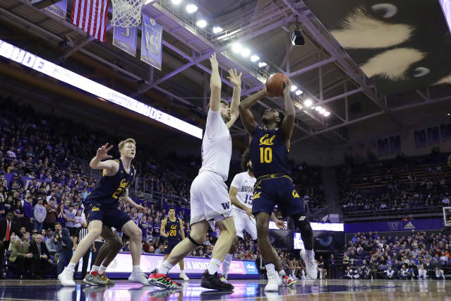 California guard Kareem South (10) shoots against Washington forward Sam Timmins, center, during the first half of an NCAA college basketball game Saturday, Feb. 22, 2020, in Seattle. (AP Photo/Ted S. Warren)
