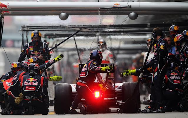 SHANGHAI, CHINA - APRIL 15: Mark Webber of Australia and Red Bull Racing drives in for a pitstop during the Chinese Formula One Grand Prix at the Shanghai International Circuit on April 15, 2012 in Shanghai, China. (Photo by Mark Thompson/Getty Images)