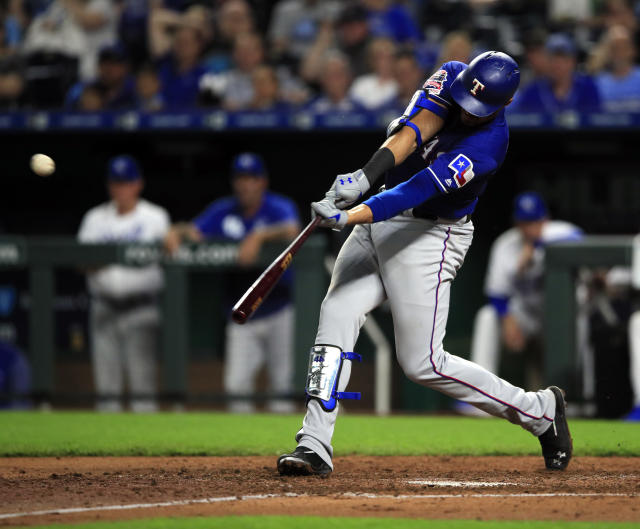 Texas Rangers' Ronald Guzman hits a two-run home run off Kansas City Royals starting pitcher Jorge Lopez (28) during the sixth inning of a baseball game at Kauffman Stadium in Kansas City, Mo., Wednesday, May 15, 2019. (AP Photo/Orlin Wagner)