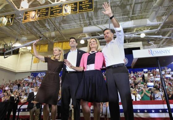Mitt Romney (R) and his wife Ann (2nd R) wave to supporters together with his running mate Paul Ryan (2nd L) and Ryan's wife Janna during a campaign event in Ashland, Virginia August 11, 2012.