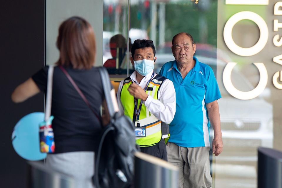 A security guard wearing a face mask standing outside the Funan Mall. (PHOTO: Dhany Osman / Yahoo News Singapore)