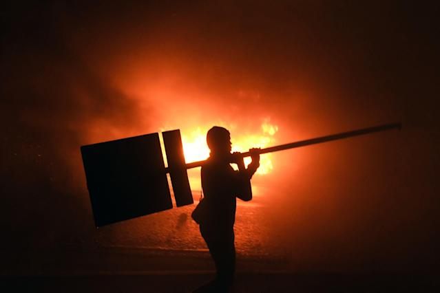 <p>Supporters of Honduran presidential candidate for the Opposition Alliance against the Dictatorship party Salvador Nasralla, set a barricade alight during a protest outside the Electoral Supreme Court (TSE), to demand the announcement of the election final results in Tegucigalpa, on Nov. 30, 2017. (Photo: Orlando Sierra/AFP/Getty Images) </p>