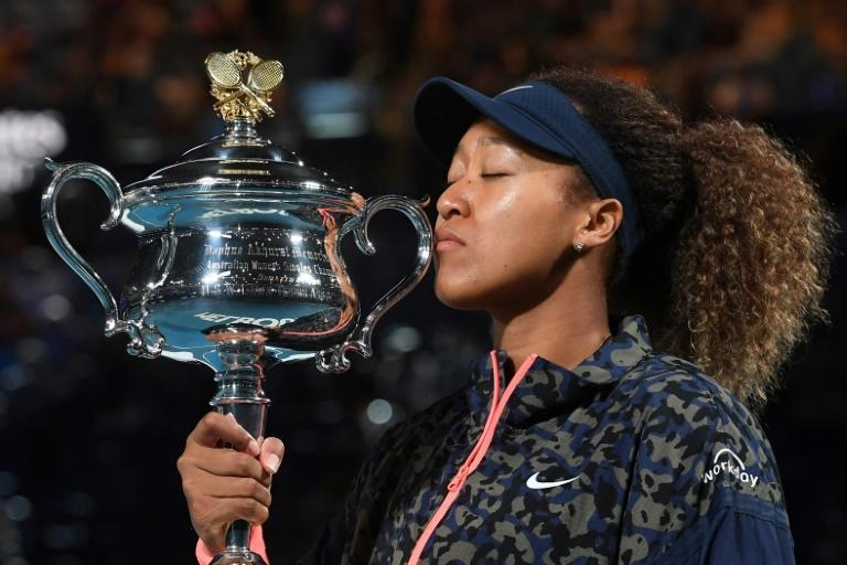 Japan's Naomi Osaka with the Daphne Akhurst Memorial Cup after winning the Australian Open on Saturday - news of her victory even reached a Japanese astronaut on the International Space Station