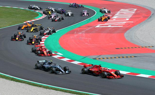 Formula One F1 - Spanish Grand Prix - Circuit de Barcelona-Catalunya, Barcelona, Spain - May 13, 2018 Ferrari's Sebastian Vettel leads Mercedes' Valtteri Bottas out of the first corner at the start of the race REUTERS/Albert Gea
