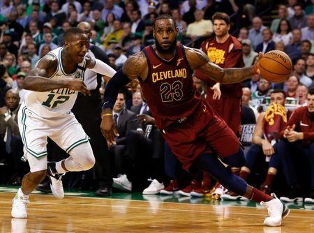 May 15, 2018; Boston, MA, USA; Cleveland Cavaliers forward LeBron James (23) drives against Boston Celtics guard Terry Rozier (12) during the second quarter of game two of the Eastern conference finals of the 2018 NBA Playoffs at TD Garden. Mandatory Credit: Greg M. Cooper-USA TODAY Sports