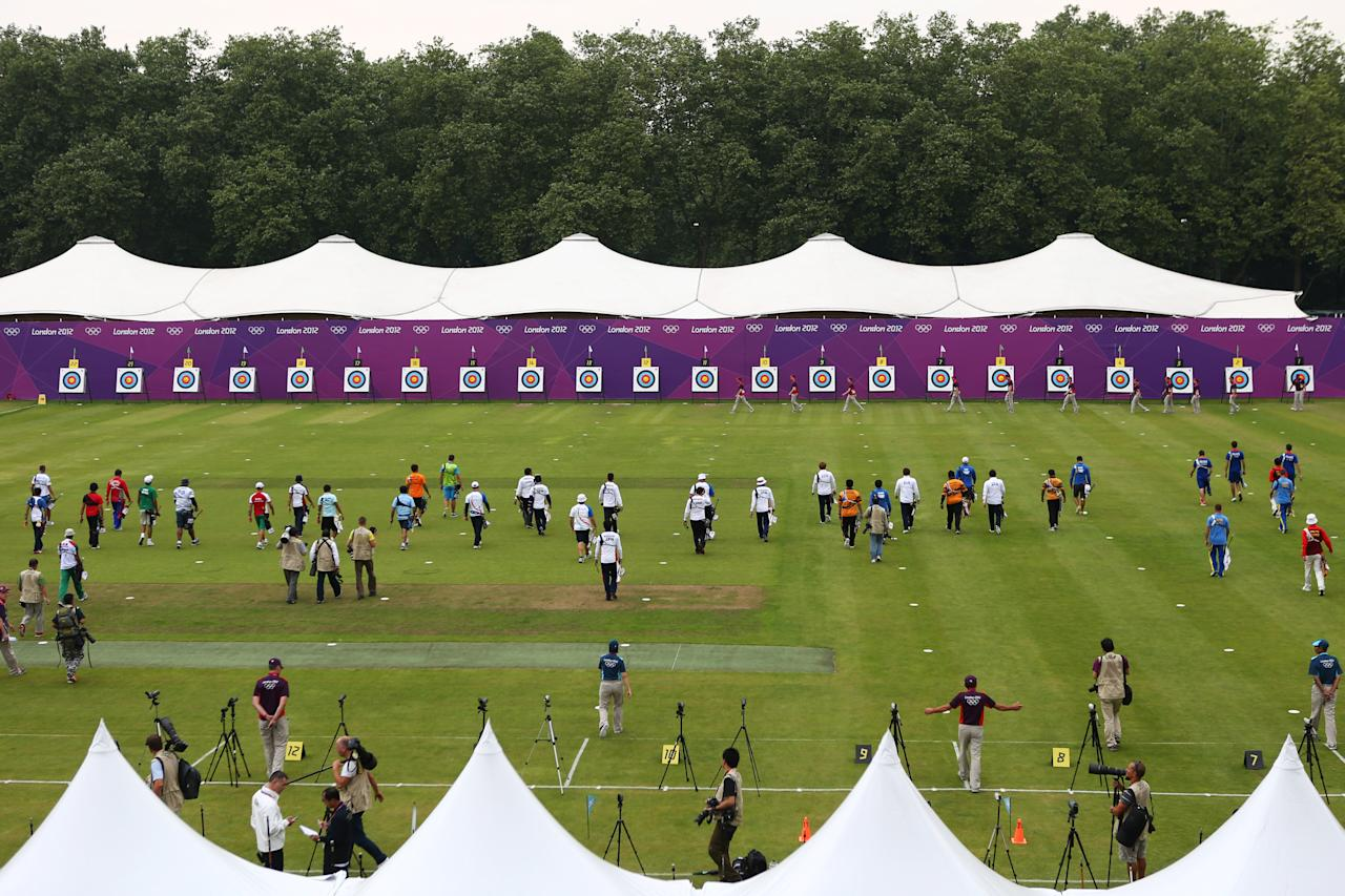 LONDON, ENGLAND - JULY 27:  Competitors walk to the targets during the Archery Ranking Round on Olympics Opening Day as part of the London 2012 Olympic Games at the Lord's Cricket Ground on July 27, 2012 in London, England.  (Photo by Paul Gilham/Getty Images)