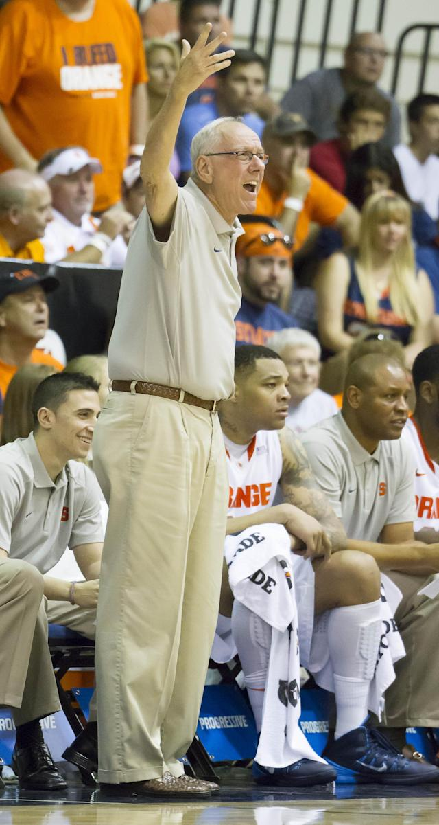 Syracuse head coach Jim Boeheim disagrees with a referees' call while his team plays against California in the first half of an NCAA college basketball game at the Maui Invitational on Tuesday, Nov. 26, 2013, in Lahaina, Hawaii. (AP Photo/Eugene Tanner)