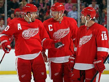 White (R) has quickly fit in on a veteran-laden Wings team, including getting the plum assignment of being paired with Nicklas Lidstrom (C)