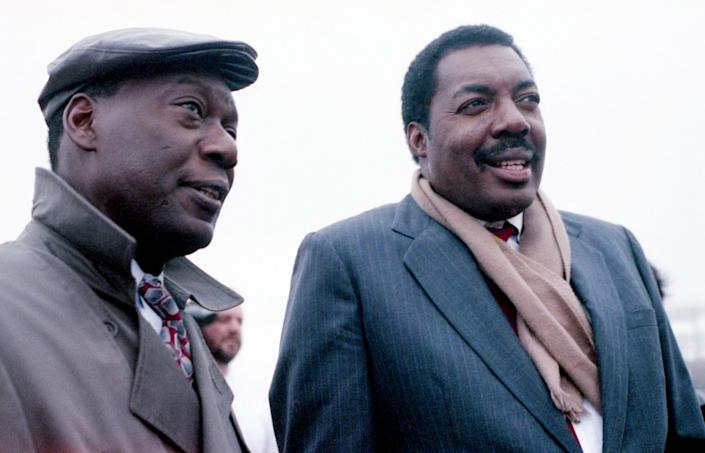 D'Army Bailey, left, chairman of The National Civil Rights Museum Foundation, and Hank Thomas, who was on the firebombed bus as a Freedom Rider in 1961, watch a replica of the bus burn at the Tennessee State Fairgrounds Feb. 7, 1991.