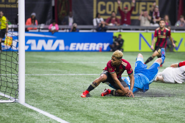 Atlanta United forward Josef Martinez (7) scores a goal in the first half of an MLS soccer game against the D.C. United on Sunday, March 11, 2018, in Atlanta. (AP Photo/Todd Kirkland)