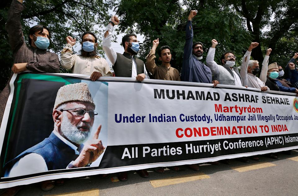 Supporters of the All Parties Hurriyet Conference chant anti Indian slogans during a demonstration against the death of Mohammed Ashraf Sehrai on 6 May (AP)