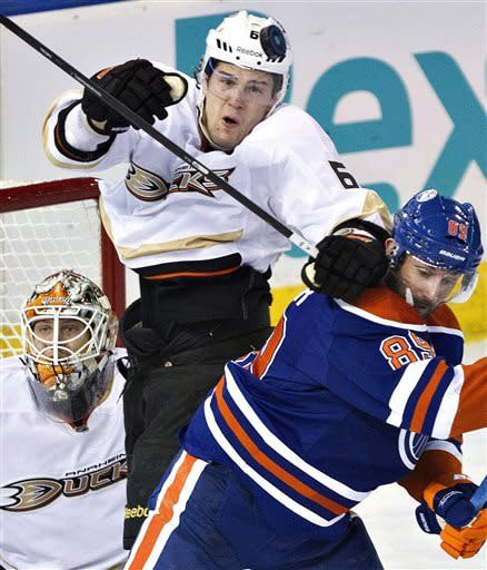 Anaheim Ducks Ben Lovejoy (6) battles for the puck with Edmonton Oilers Sam Gagner as goalie Viktor Fasth looks for the rebound during first period NHL hockey action in Edmonton, on Monday April 22, 2013. (AP Photo/The Canadian Press, Jason Franson)