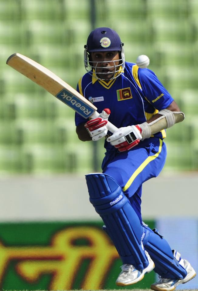 Sri Lankan captain Mahela Jayawardene plays a shot during the one day international (ODI) Asia Cup cricket match between Pakistan and Sri Lanka at The Sher-e-Bangla National   Cricket Stadium in Dhaka on March 15, 2012.