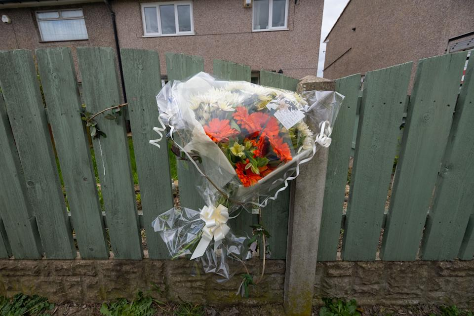 Floral tributes left outside a house. (Tom Maddick/SWNS)