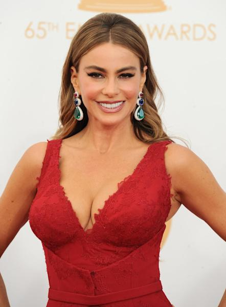 Sofia Vergara, wearing Vera Wang, arrives at the 65th Primetime Emmy Awards at Nokia Theatre on Sunday Sept. 22, 2013, in Los Angeles. (Photo by Jordan Strauss/Invision/AP)