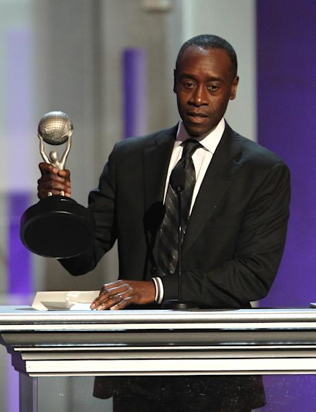 """Don Cheadle accepts the award for outstanding actor in a comedy series for """"House of Lies"""" at the 44th Annual NAACP Image Awards at the Shrine Auditorium in Los Angeles on Friday, Feb. 1, 2013. (Photo by Matt Sayles/Invision/AP)"""