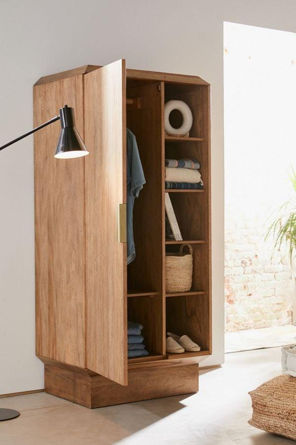 """<p>Short on closet space? You need this <a href=""""https://www.popsugar.com/buy/Finley-Armoire-460907?p_name=Finley%20Armoire&retailer=urbanoutfitters.com&pid=460907&price=899&evar1=casa%3Aus&evar9=46534838&evar98=https%3A%2F%2Fwww.popsugar.com%2Fhome%2Fphoto-gallery%2F46534838%2Fimage%2F46535123%2FFinley-Armoire&list1=shopping%2Corganizing%2Cfurniture%2Corganization%2Cbedrooms%2Chome%20organization%2Chome%20shopping&prop13=mobile&pdata=1"""" rel=""""nofollow"""" data-shoppable-link=""""1"""" target=""""_blank"""" class=""""ga-track"""" data-ga-category=""""Related"""" data-ga-label=""""https://www.urbanoutfitters.com/shop/finley-armoire?category=furniture&amp;color=020&amp;type=REGULAR"""" data-ga-action=""""In-Line Links"""">Finley Armoire</a> ($899).</p>"""