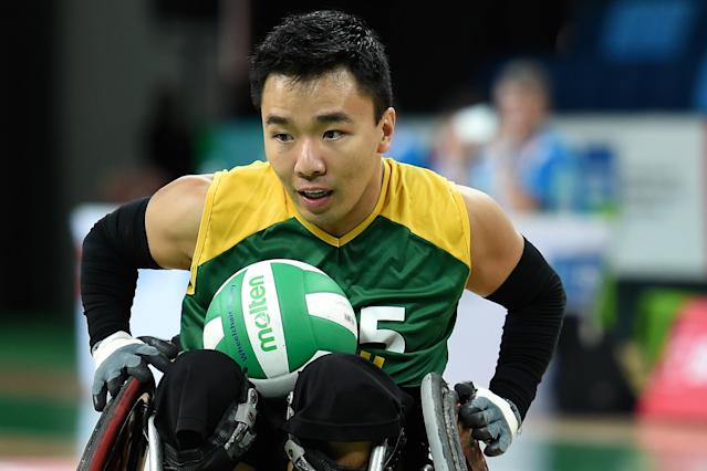 RIO DE JANEIRO, BRAZIL - FEBRUARY 26: Alexandre Kenji Taniguchi of Brazil scores a try during the International Wheelchair Rugby Championship - Aquece Rio Test Event for the Rio 2016 Paralympics match between Brazil and Canada at Olympic Park on February 26, 2016 in Rio de Janeiro, Brazil. (Photo by Buda Mendes/Getty Images)