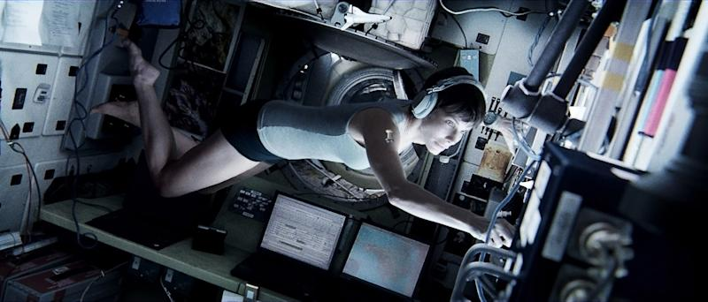 """This publicity photo released by courtesy of Warner Bros. Pictures shows Sandra Bullock, as Dr. Ryan Stone, in Warner Bros. Pictures' sci-fi thriller """"Gravity,"""" a Warner Bros. Pictures release. (AP Photo/Courtesy Warner Bros. Pictures)"""