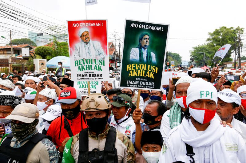 FILE PHOTO: People gather for the homecoming of Rizieq Shihab, the leader of Indonesian Islamic Defenders Front (FPI) who has resided in Saudi Arabia since 2017