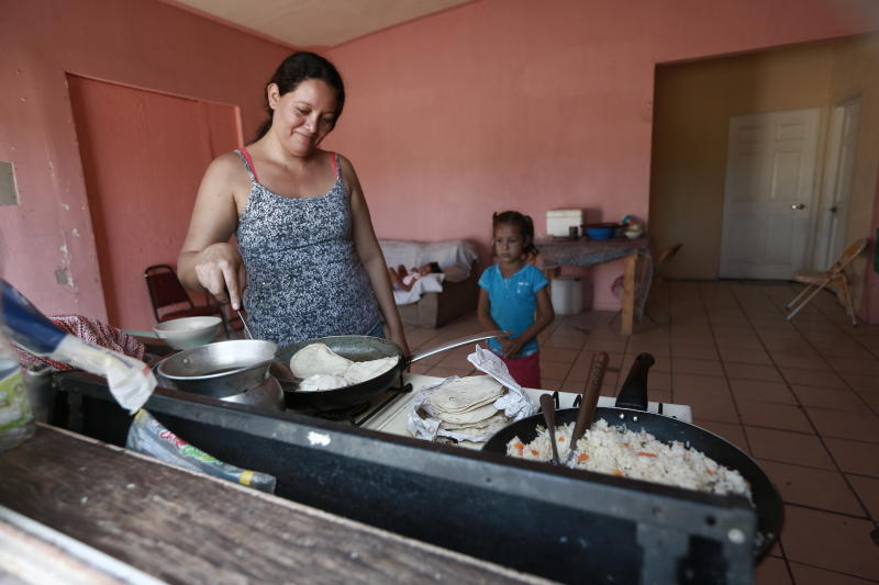 "A Honduran migrant prepares tortillas and rice at the Pan de Vida shelter for migrants where she and her two daughters are living while waiting their turn to apply for asylum in the U.S. in Ciudad Juarez, Mexico, Thursday, Sept. 12, 2019. Mexican Foreign Secretary Marcelo Ebrard said Thursday that Mexico's government doesn't agree with an ""astonishing"" U.S. Supreme Court order that would block migrants from countries other than Mexico and Canada from applying for asylum at U.S. borders. (AP Photo/Christian Chavez)"