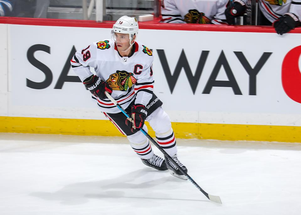 WINNIPEG, MB - FEBRUARY 16: Jonathan Toews #19 of the Chicago Blackhawks keeps an eye on the play during third period action against the Winnipeg Jets at the Bell MTS Place on February 16, 2020 in Winnipeg, Manitoba, Canada. The Jets defeated the Hawks 3-2. (Photo by Jonathan Kozub/NHLI via Getty Images)