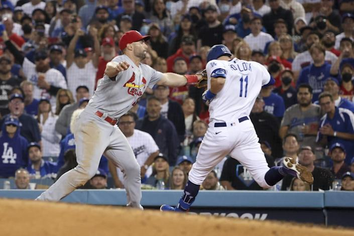 St. Louis Cardinals first baseman Paul Goldschmidt tags out Los Angeles Dodgers' AJ Pollock at first base