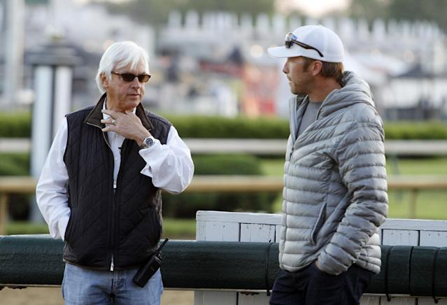 Trainer Bob Baffert talks to Bode Miller during a morning workout at Churchill Downs Friday, May 2, 2014, in Louisville, Ky. (AP Photo/Garry Jones)
