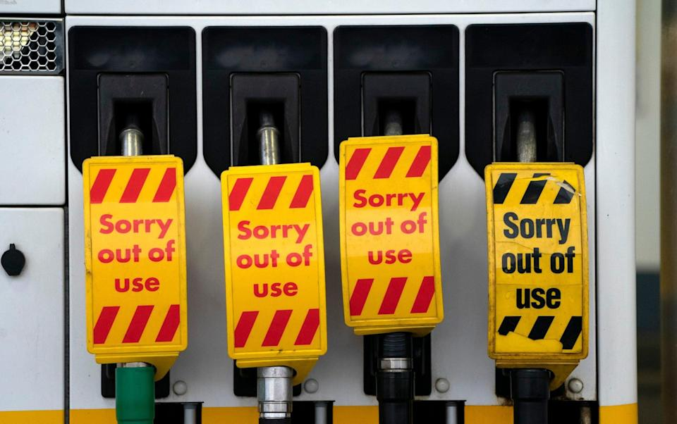 Closed petrol pumps at a petrol station in Manchester - AP