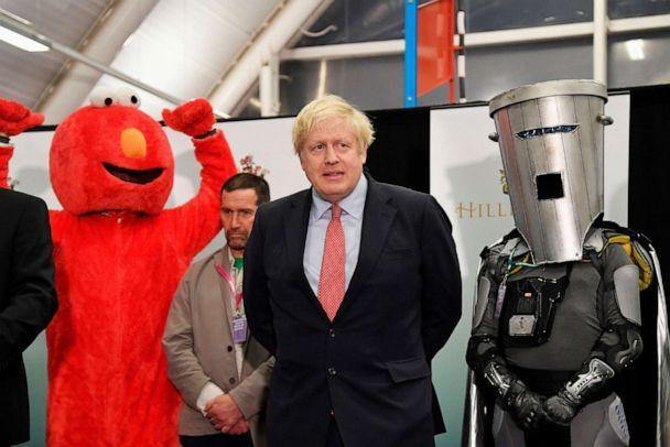 PHOTO: British Prime Minister Boris Johnson looks on, between Independent candidate Bobby 'Elmo' Smith and Independent candidate Count Binface, after winning his seat of Uxbridge and South Ruislip in Uxbridge, Britain, Dec. 13, 2019. (Toby Melville/Reuters, FILE)