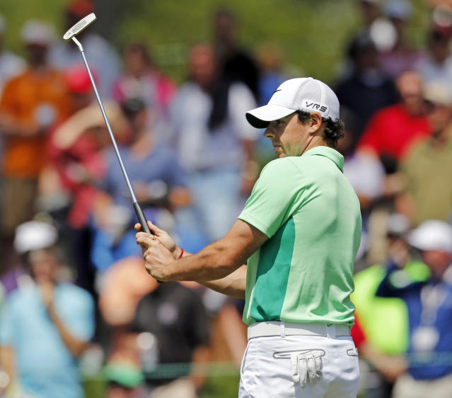 Rory McIlroy, of Northern Ireland, reacts after missing a putt on the fifth hole during the second round of the Wells Fargo Championship golf tournament in Charlotte, N.C., Friday, May 2, 2014. (AP Photo/Nell Redmond)