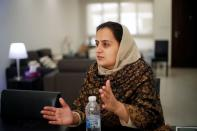 Afghan news anchor Beheshta Arghand speaks to her brother at a temporary residence compound in Doha