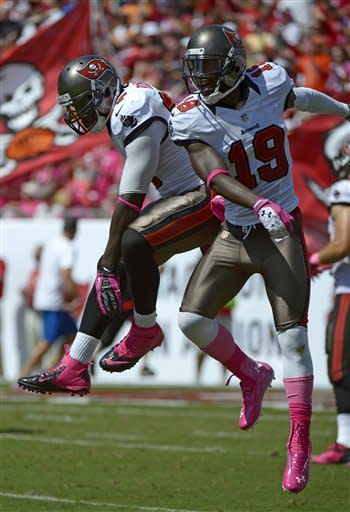 Tampa Bay Buccaneers wide receiver Mike Williams (19) celebrates after catching a pass for a 62-yard touchdown against the Kansas City Chiefs with teammate LeGarrette Blount (27) during the first half of an NFL football game, Sunday, Oct. 14, 2012, in Tampa, Fla. (AP Photo/Phelan M. Ebenhack)