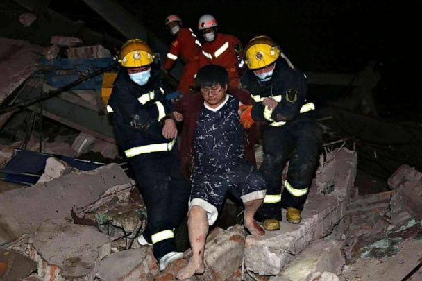 PHOTO:Rescuers help a man from the rubble of a collapsed hotel building in Quanzhou city in southeast China's Fujian province, March 7, 2020. (AP)
