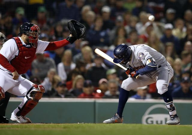 Houston Astros' Carlos Correa, right, ducks an inside pitch as Boston Red Sox's Sandy Leon catches during the first inning of a baseball game in Boston, Sunday, Sept. 9, 2018. (AP Photo/Michael Dwyer)