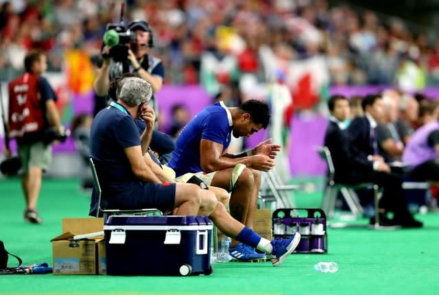 France's Sebastien Vahaamahina sits out after receiving a red card (David Davies/PA)