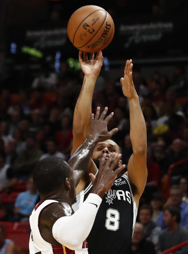 San Antonio Spurs guard Patty Mills (8) shoots the ball against Miami Heat guard Kendrick Nunn (25) in the first half of an NBA basketball game, Wednesday, Jan. 15, 2020, in Miami. (AP Photo/Brynn Anderson)